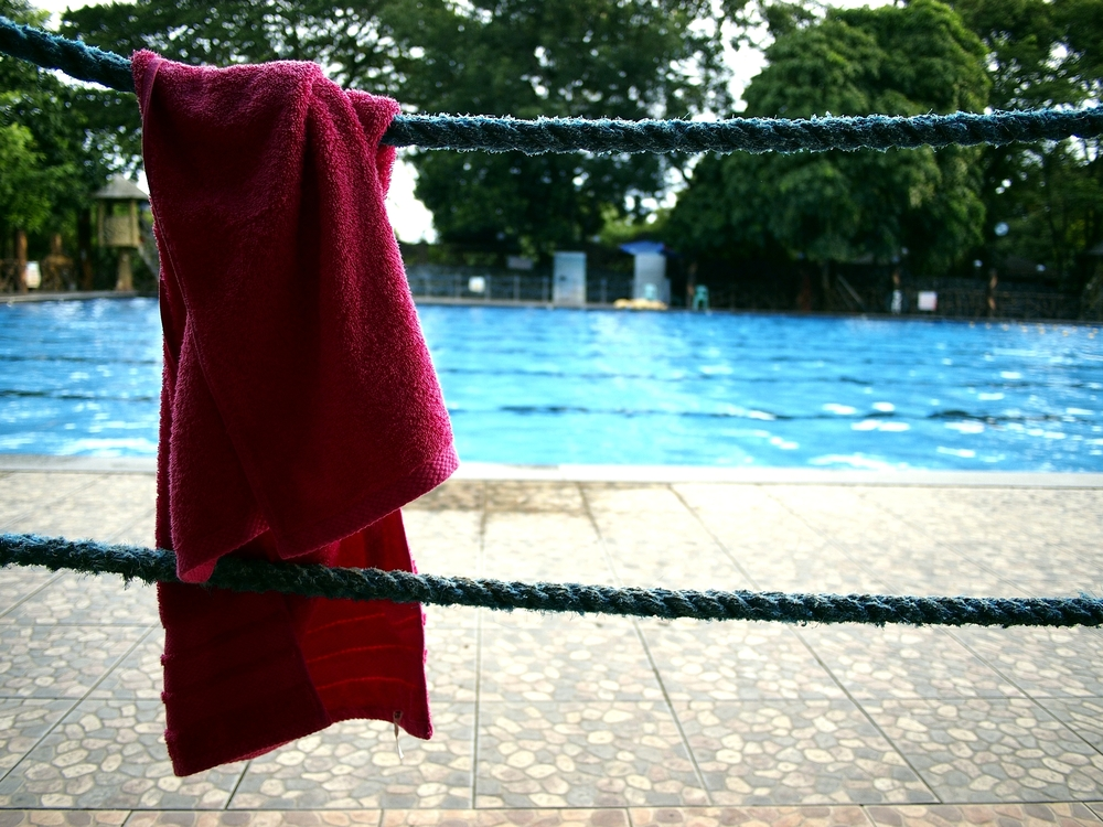 Red Custom Towel Hanging by Swimming Pool