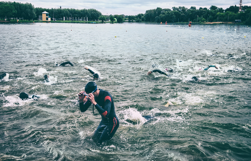 athlete half coming out of water