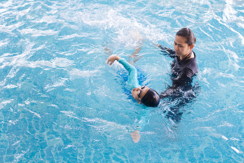 girl taking swimming lessons