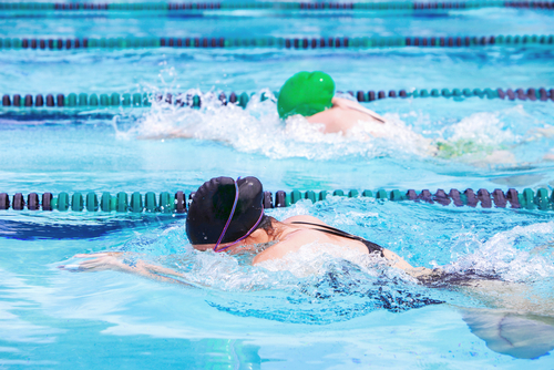 swimmers competing in swim meet
