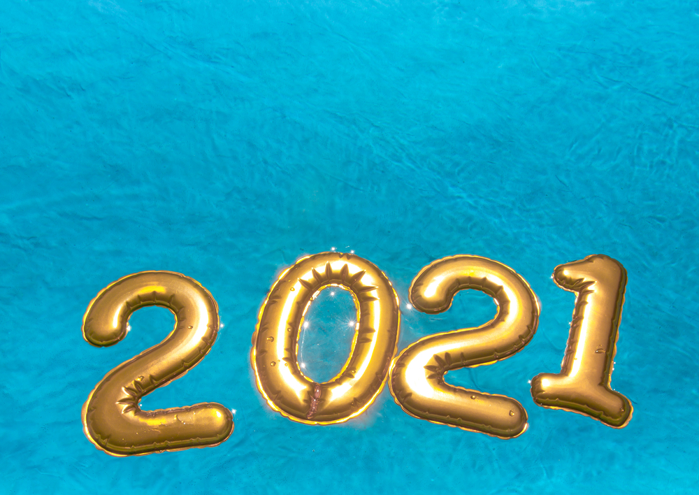 on blue azure sea water golden numbers balls 2021 new year float